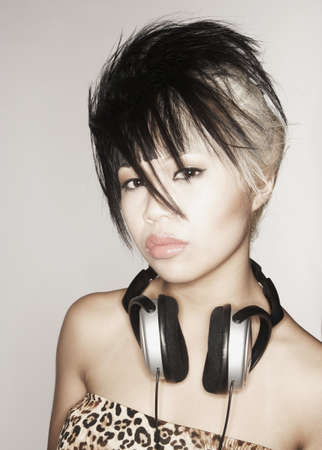 Young Asian woman with headphones around neck