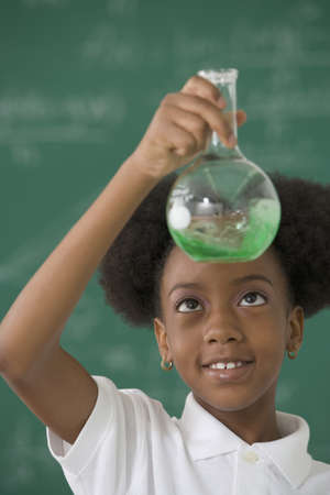 African American girl in science class