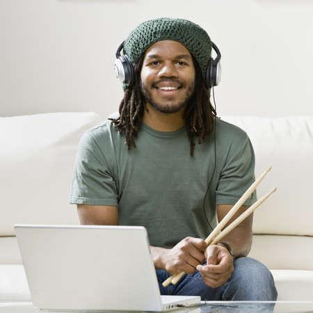 African man holding drumsticks