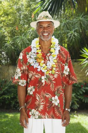 African man wearing Hawaiian shirt and leis