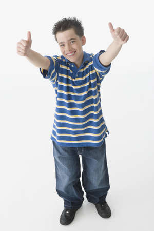 Hispanic boy giving two thumbs up