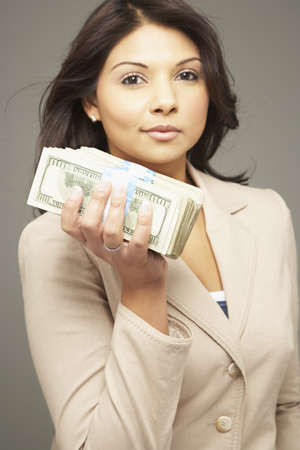 Asian woman holding stack of money