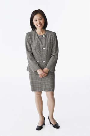 Asian businesswoman with hands clasped