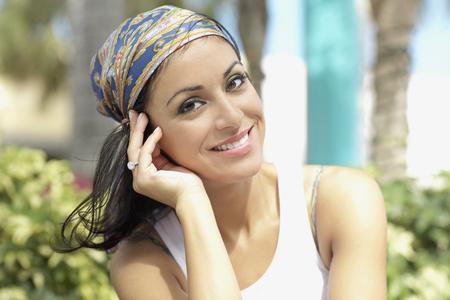 Hispanic woman wearing scarf on head
