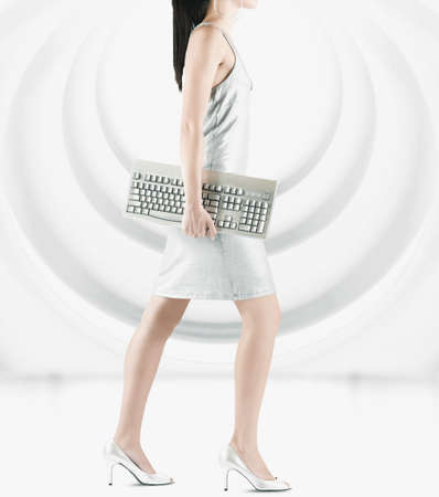 Pacific Islander woman carrying computer keyboard LANG_EVOIMAGES