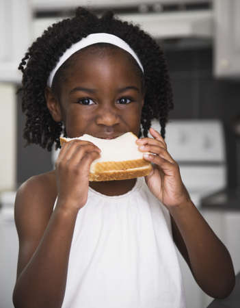 African girl eating sandwich