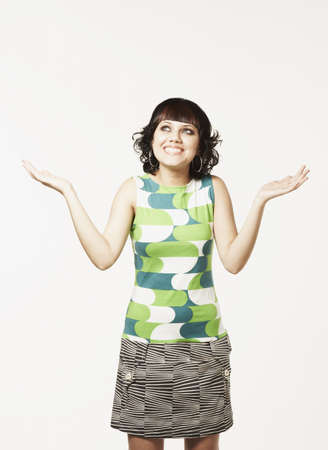 Mixed Race woman shrugging shoulders
