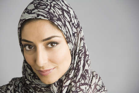 Middle Eastern woman wearing headscarf LANG_EVOIMAGES
