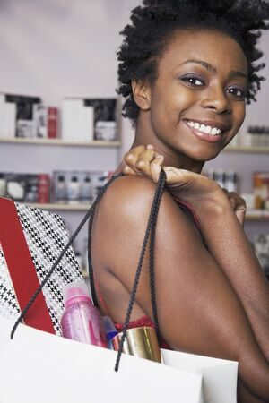 African woman carrying shopping bag LANG_EVOIMAGES
