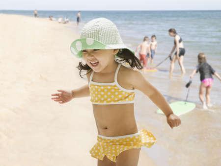 Asian girl playing at beach