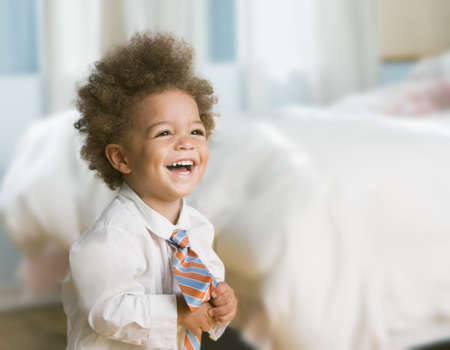 Mixed Race baby wearing button-down shirt and necktie