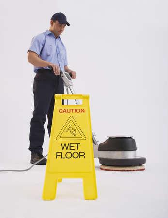 Hispanic man cleaning floor