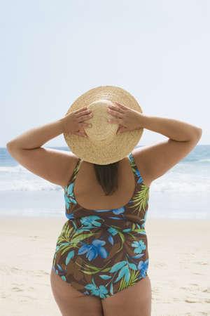 Overweight Hispanic woman at beach