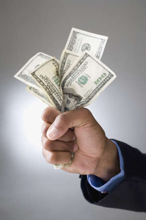 Mixed Race businessman holding money