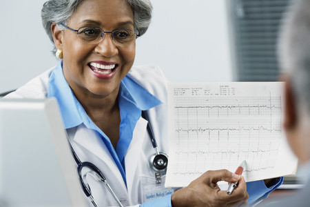 African female doctor explaining electrocardiogram to patient
