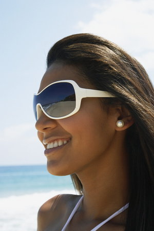 Hispanic woman wearing sunglasses