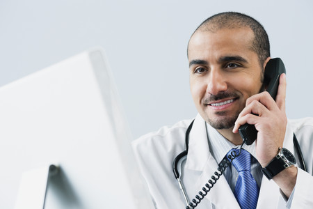 Lebanese male doctor talking on telephone