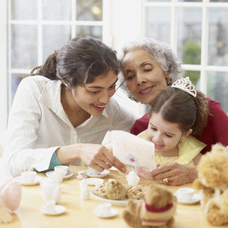Multi-generational Hispanic family having tea party LANG_EVOIMAGES