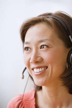 Asian businesswoman wearing headset
