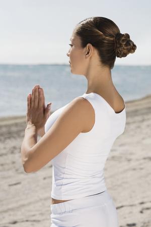 Hispanic woman practicing yoga LANG_EVOIMAGES
