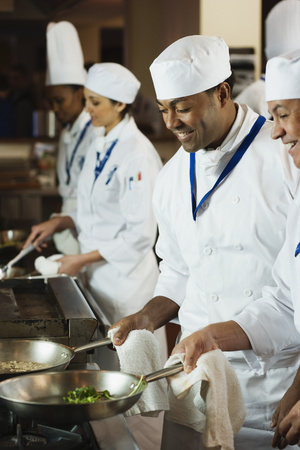 Multi-ethnic chefs preparing food