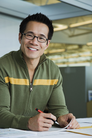 Asian American businessman working in office LANG_EVOIMAGES