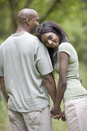 African couple holding hands outdoors LANG_EVOIMAGES