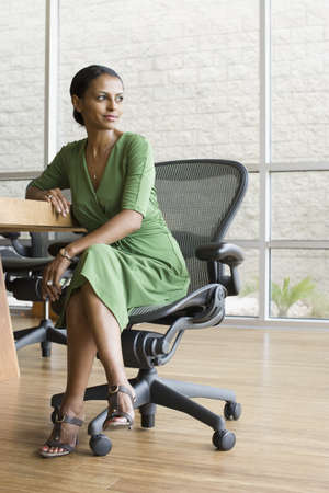 African businesswoman sitting in chair LANG_EVOIMAGES