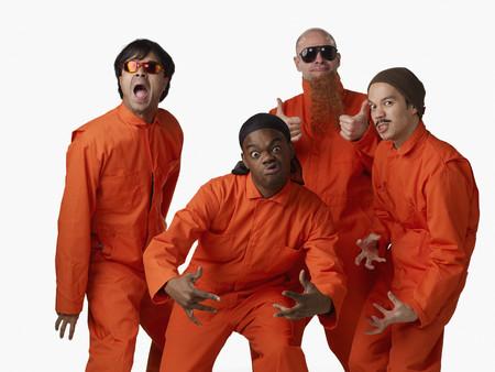 Multi-ethnic criminals in prison uniforms