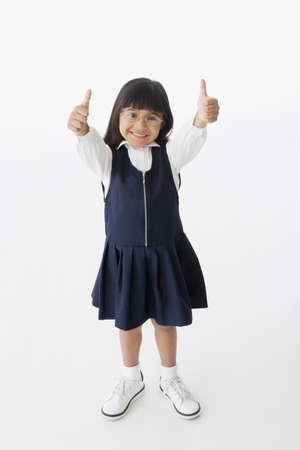 Hispanic girl giving thumbs up