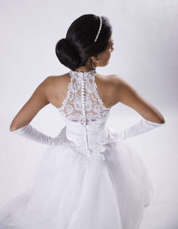 Hispanic bride with hands on hips LANG_EVOIMAGES