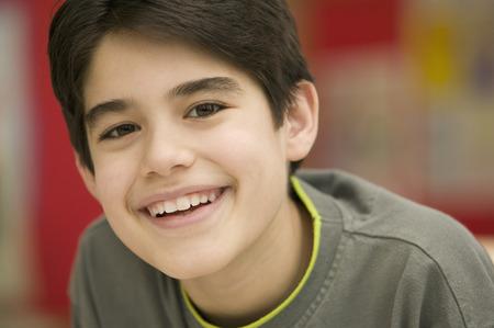 Portrait of Hispanic boy smiling LANG_EVOIMAGES