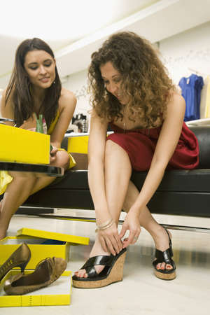 Multi-ethnic women shoe shopping