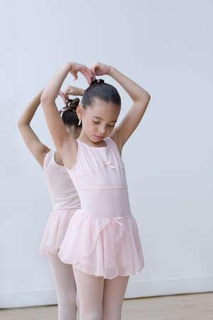 Hispanic girl practicing ballet in tutu