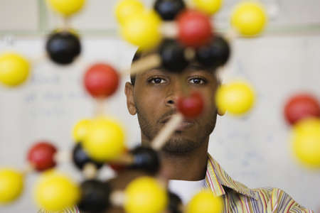 African teacher behind molecule model