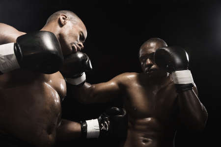 African boxer hitting opponent