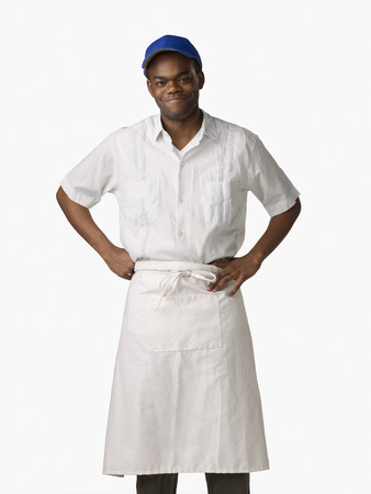 African man wearing cook's uniform LANG_EVOIMAGES