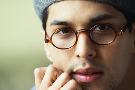 Hispanic man wearing eyeglasses and hat