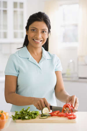 Indian woman cutting vegetables