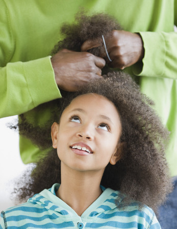 African father styling daughters hair