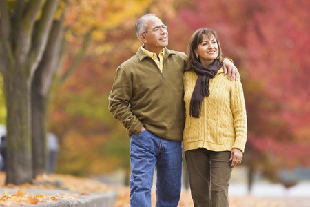 Hispanic couple walking outdoors in autumn LANG_EVOIMAGES