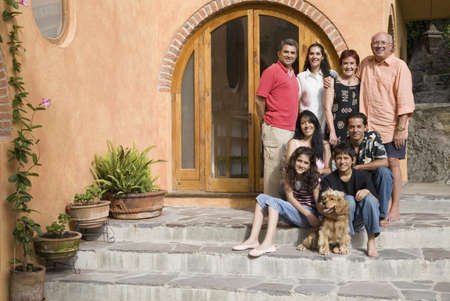 Portrait of multi-generational Hispanic family LANG_EVOIMAGES