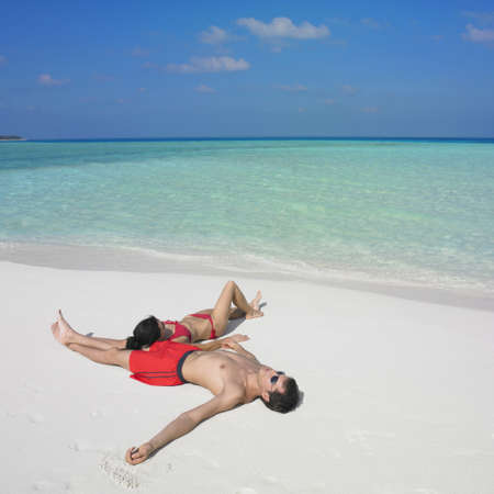 Couple laying on beach