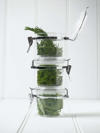 Stack of mason jars with herbs LANG_EVOIMAGES