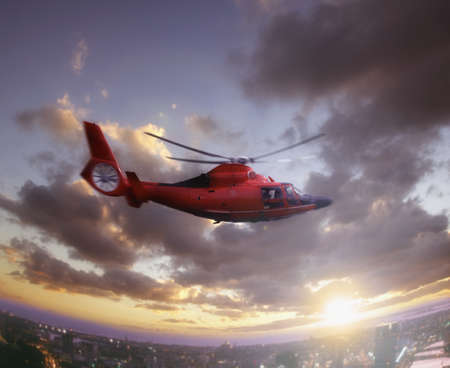 Helicopter in flight over city
