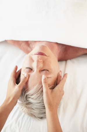 Middle-aged woman receiving massage