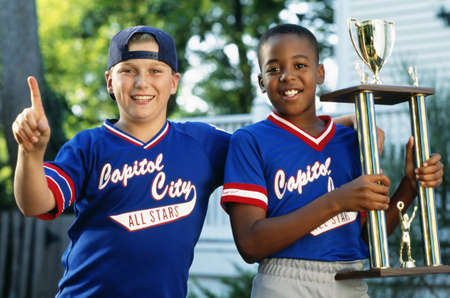 Two boys with baseball trophy