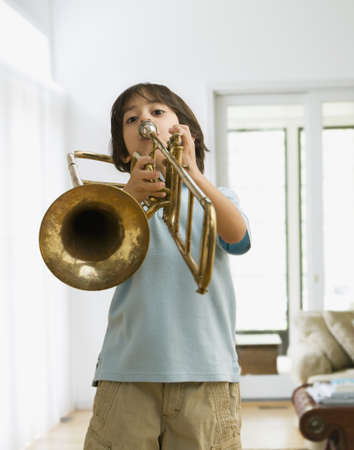 Hispanic boy playing trombone