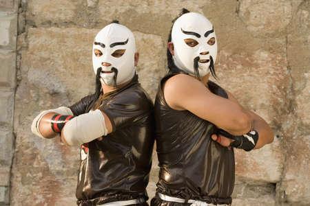 Hispanic men wearing Mexican wrestling costumes LANG_EVOIMAGES