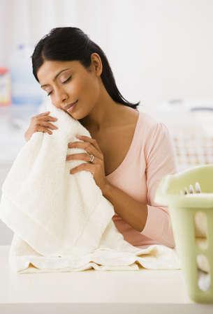Indian woman feeling soft towel